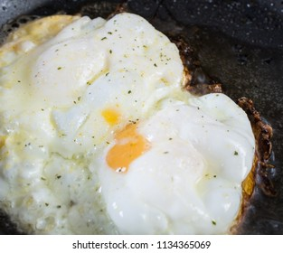 Two fried eggs in a pan