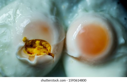 two fried eggs or sunny side up being compared next to one another; one looking round, flawless and perfect, the other was flawed and broken