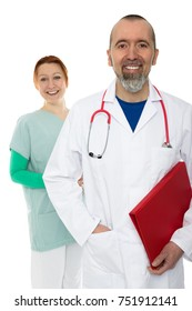Two friendly medical staff are smiling at the camera