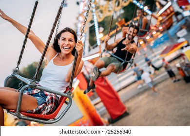 Two friends at amusement park. Soft focus, high ISO, grainy image.