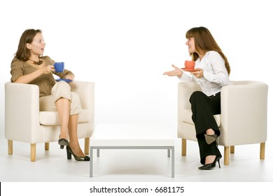 Two friends chatting with tea, isolated on white