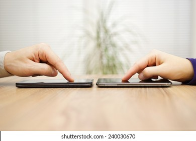 two friends are connecting and sharing files over smart phones