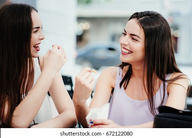 Two friends cute talk and eat coffee