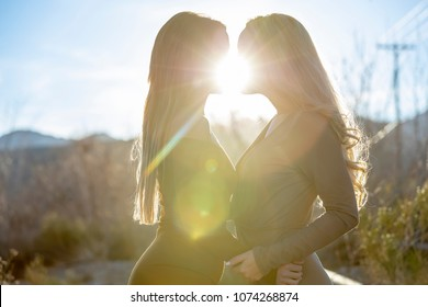Two friends enjoying each others company in an outdoor environment