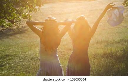 Two friends enjoying the summer sun