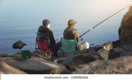 Two friends fishing to escape stressed city life, common interests, free time