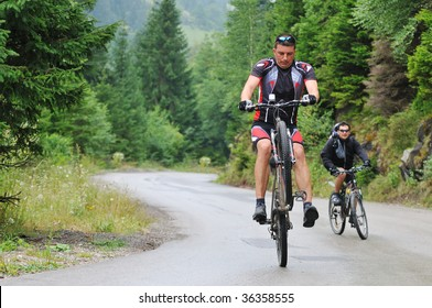 two friends have fun outdoor in nature and representing concept of  healthy life and fitnes on muntain bike