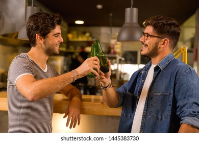 Two friends having a drink at the pub and making a toast