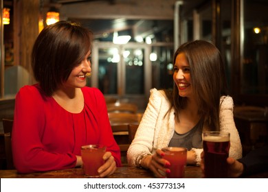Two friends having a drink in a pub