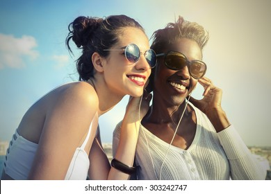 Two friends listening to music