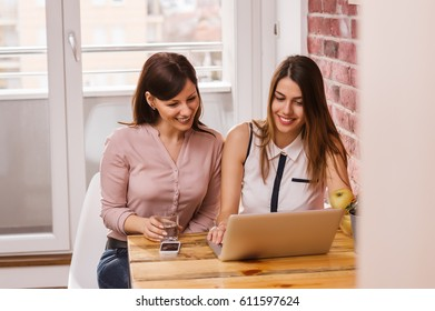 Two friends looking for some webshoping