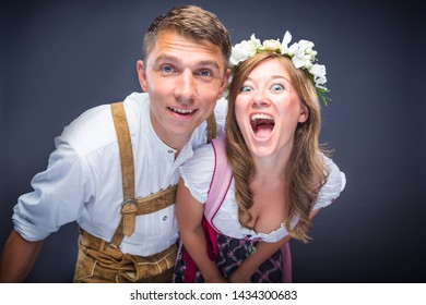 Two friends, men and women having fun in Bavarian Tracht