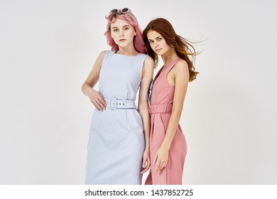two friends on a light background stylish clothes