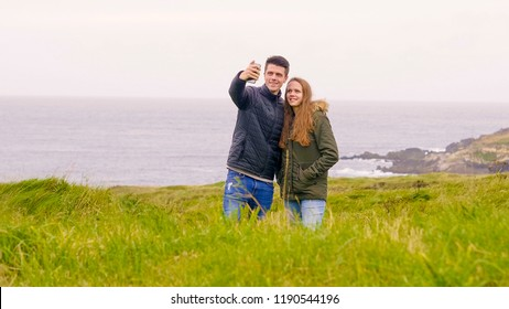 Two friends on vacation in Ireland take a selfie