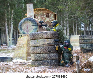Two friends in paintball club with a model of steam locomotive