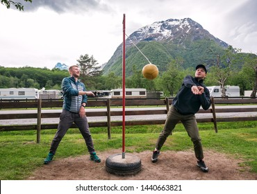 two friends are playing tetherball game in Norwegian camping