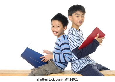 Two friends reading a book-back to back