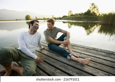 Two friends relaxing on the pier.