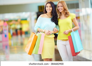 Two friends shopping together in shopping mall