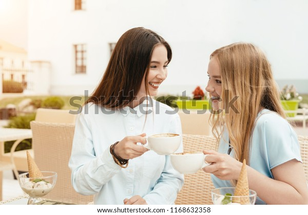 Two Friends Sisters Talking Taking Conversation Stock Photo
