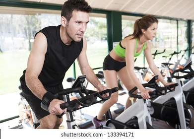 two Friends Are In A Spinning Class At Gym
