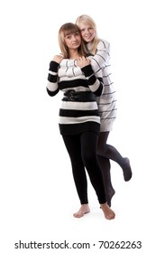 Two friends in striped jackets cuddling on white background
