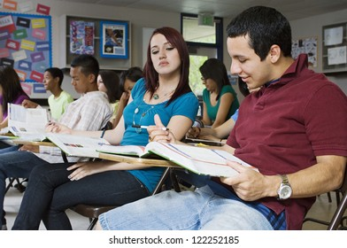 Two friends studying together in classroom