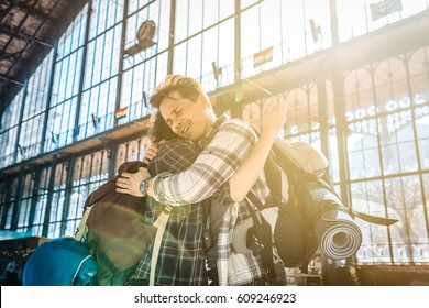 two friends traveling, embracing each other after a long time of absence