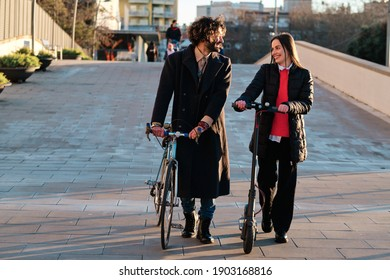 Two friends walking together outdoors at city street.