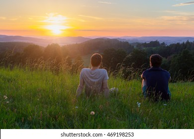 Two friends watching sunset in Czech Republic stock photo