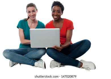 Two friends watching videos on laptop