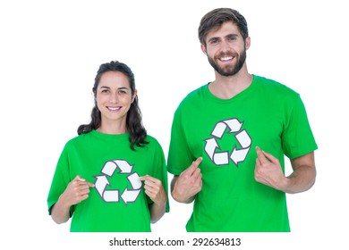Two friends wearing recycling tshirts pointing themselves