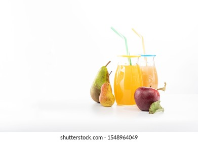 Two fruit drinks. Red apple and green pears.
