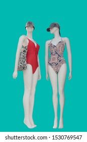 Two full-length female mannequins wearing fashionable bathing suits, isolated on white background. No brand names or copyright objects.