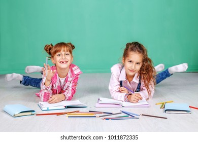 Two fun little children do homework. The concept of childhood, learning, friendship, family, school, lifestyle.