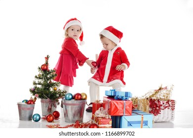 two funny baby girl santas over the white