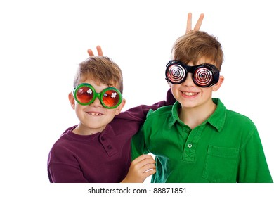 Two funny boys with silly glasses on.
