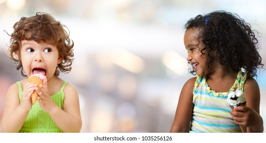 Two funny kid girls eating ice cream