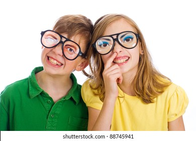 Two funny kids with weird novelty glasses on.