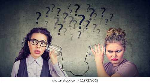 Two funny looking women having troubled communication
