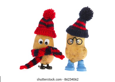 Two funny potato heads in winter outfit