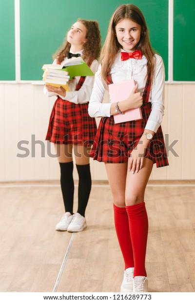 Two Funny Schoolgirls School Uniform Standing Arkistokuva Muokkaa