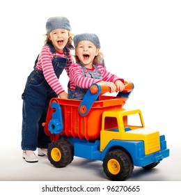 two funny twins girls with toy car