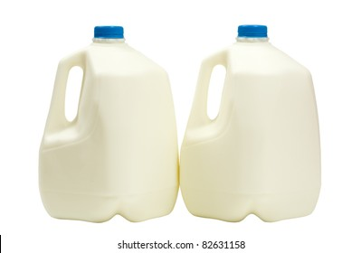 Two gallons of milk in plastic containers; isolated on white background