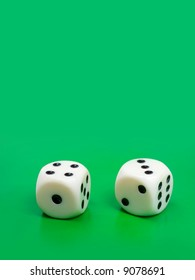 Two gambling dices on green background