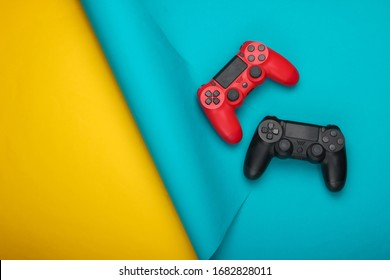 Two gamepads on blue yellow  background. Gaming, leisure and entertainment concept. Top view