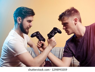 Two gamers head to head, red and blue player with game controllers, tournament , competition concept