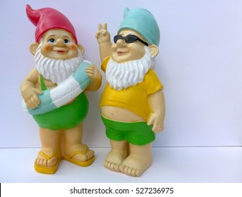 Two garden gnomes  against a white background
