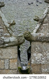 Two gargoyles worn by the elements at Plougonven Parish close in Bretagne France