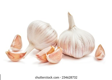 Two garlic bulbs and cloves isolated on white background